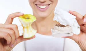 Как привыкнуть к новым зубам